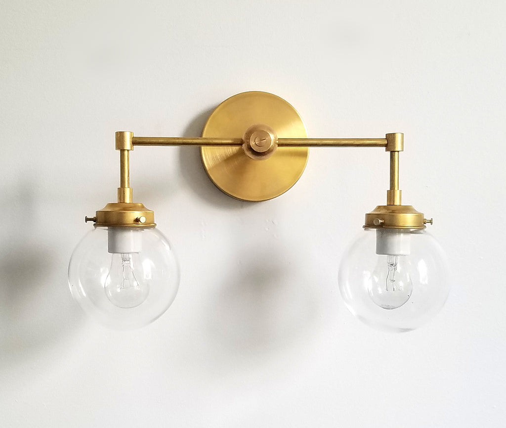 Brass and clear glass two light modern wall sconce bathroom lighting