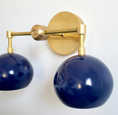 brass and navy nautical wall sconce
