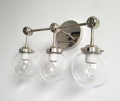 chrome three-light wall sconce