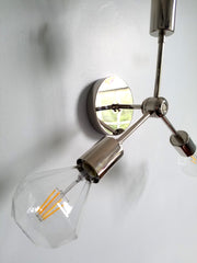detail of chrome wall sconce or flushmount light fixture