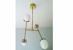 minimalist modern brass lighting with glass chandelier