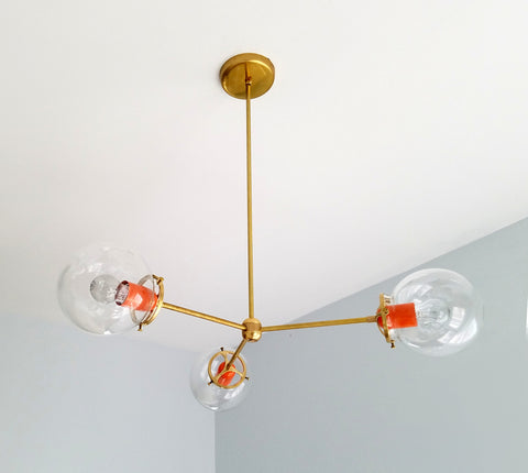 Cadiz Three Light Chandelier:  modern chandelier in chrome or brass with a pop of color