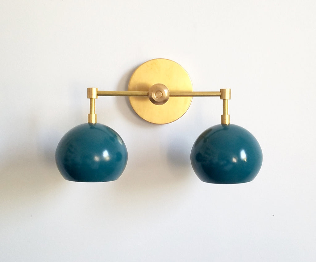 teal and brass two light bathroom vanity fixture modern