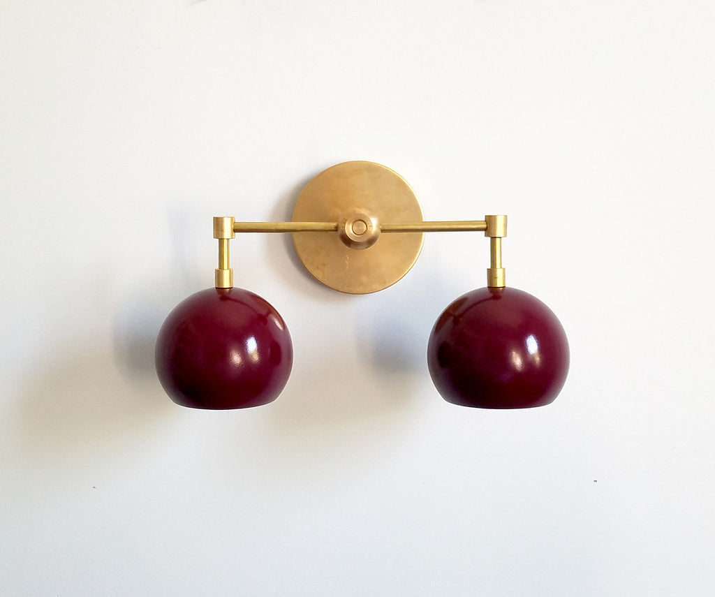brass and maroon two-light modern wall sconce bathroom lighting