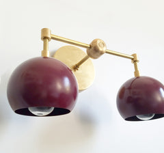 brass and blackberry two-light midcentury modern inspired lighting