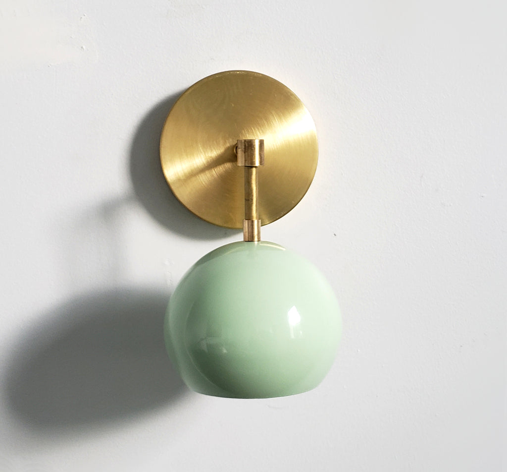 brass and mint single light wall sconce accent lighting midcentury inspired eyeball globe shade