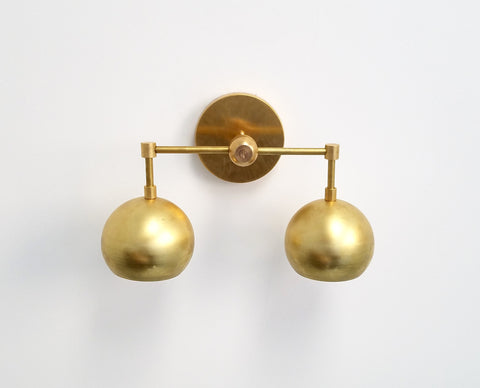 Double Loa Sconce in Raw Brass