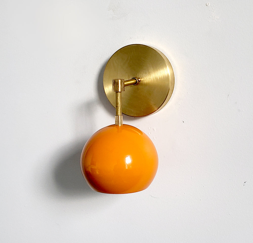brass and orange mid century modern wall sconce accent lighting