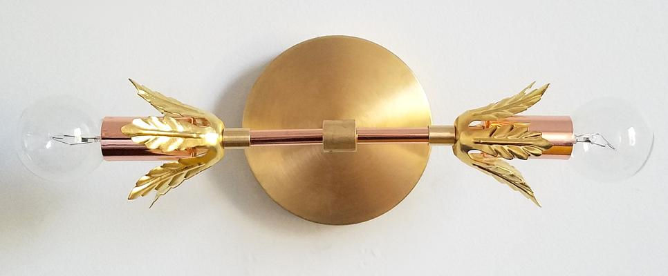 Brass and copper wall sconce