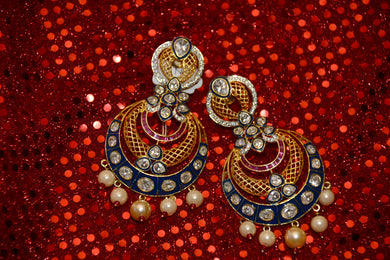 Something to go with your Garba night couture. Also wear with saris, suits and kurtis. This colorful pair of earrings is a traditional work of art, only for you.