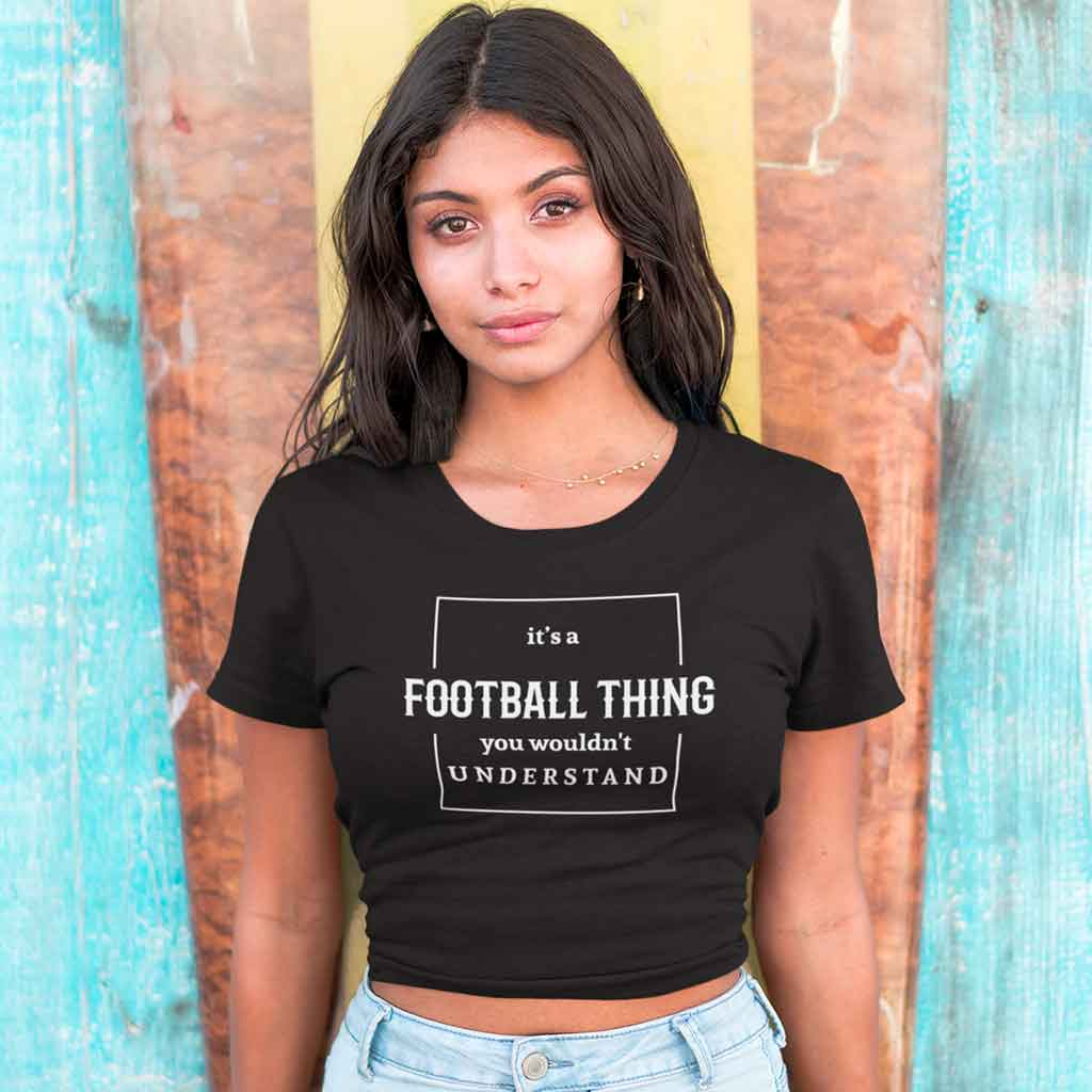 black-crop-t-shirt-for-girl-standing-against-a-surfboard