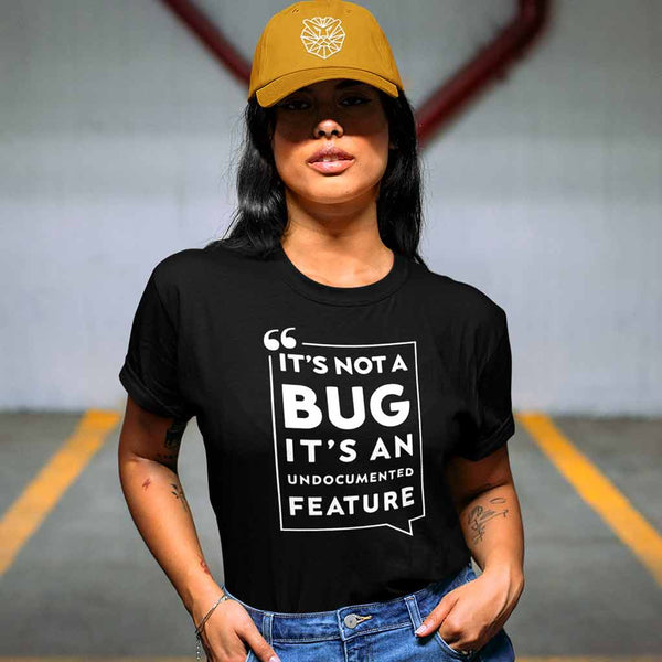 black-developer-t-shirts-featuring-a-woman-with-a-hat-on-a-parking-garage
