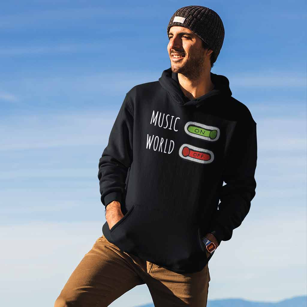 black-hoodies-for-men-online--featuring-a-man-at-the-top-of-a-mountain