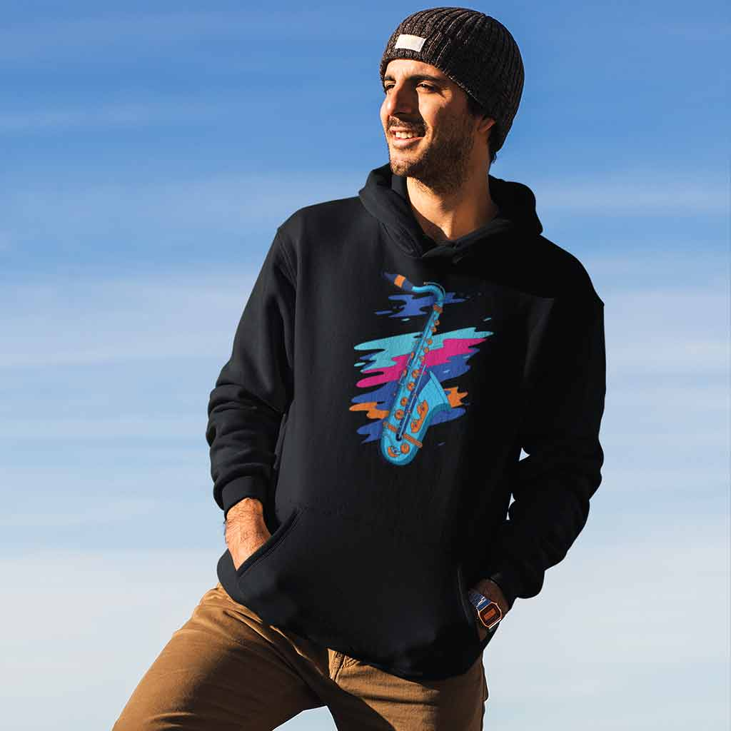 black-hoodies-for-men-online-india-featuring-a-man-at-the-top-of-a-mountain