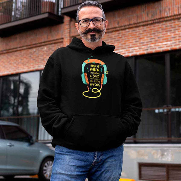 middle-aged-man-wearing-black-winter-hoodies-for-men-on-the-street