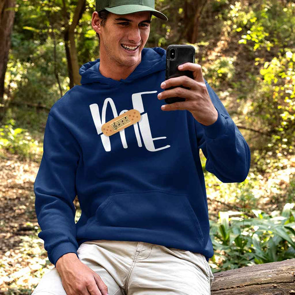 navy-blue-branded-hoodies-for-men-featuring-a-man-in-the-woods-checking-his-mobile