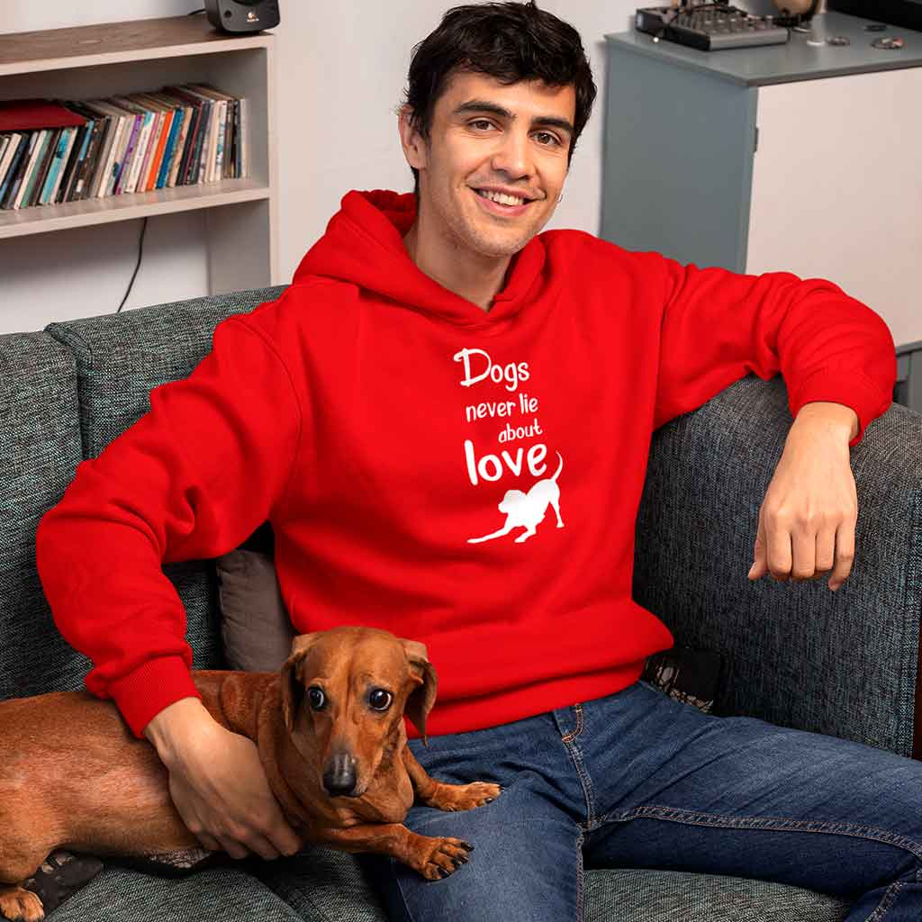 red-hoodies-for-men-online-india-featuring-a-young-man-sitting-on-a-couch