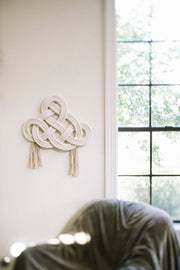 cotton rope wall hanging on white wall near window