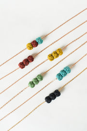 colorful fair trade handmade necklaces on white background