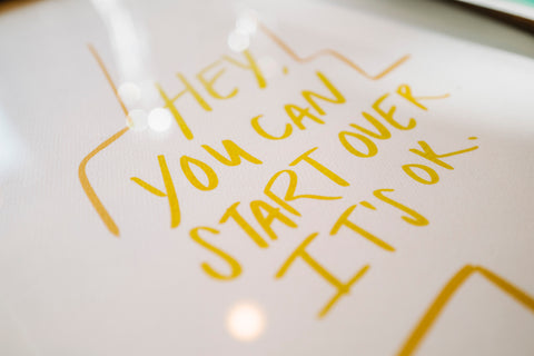close up image of hand lettered artwork that says hey, you can start over, it's ok