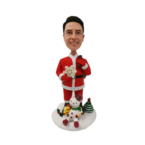 Santa Holding Snowflake and Snowman at His Feet Bobblehead