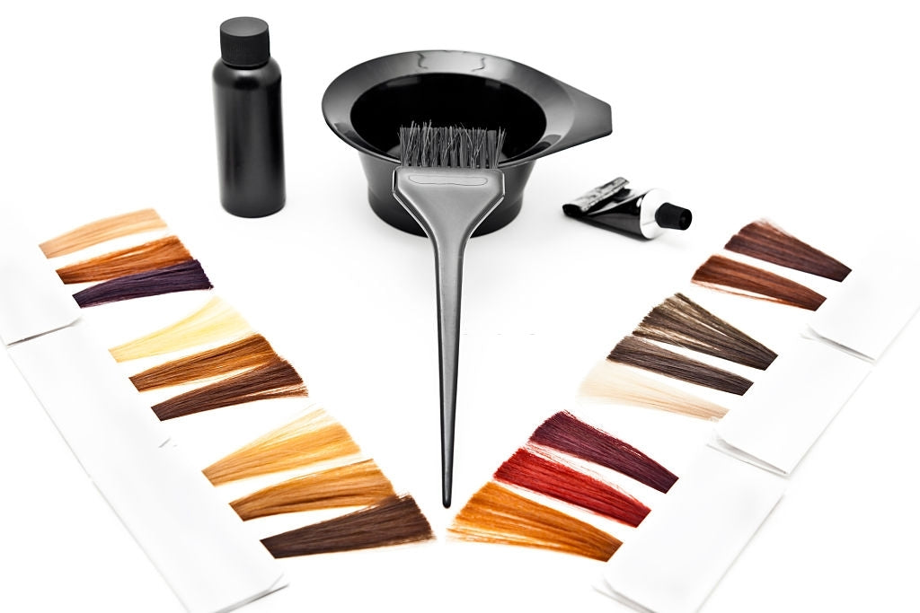 hair coloring tube with color developer, bowl, brush and hair color palette