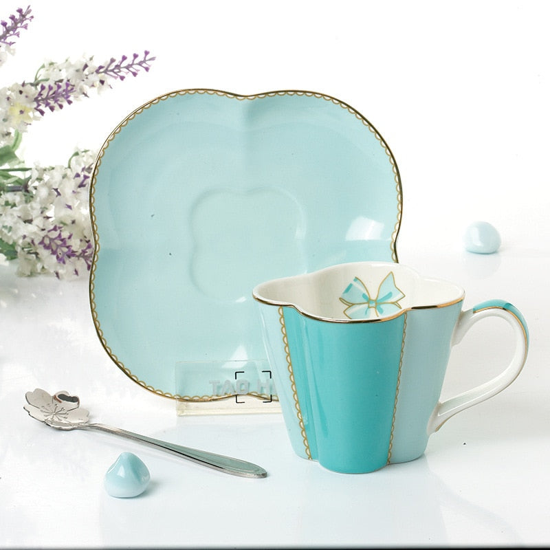 YeFine Ceramic Coffee Cup And Saucer Four Leaf Clover Design Porcelain Tea Cup Set With Stainless