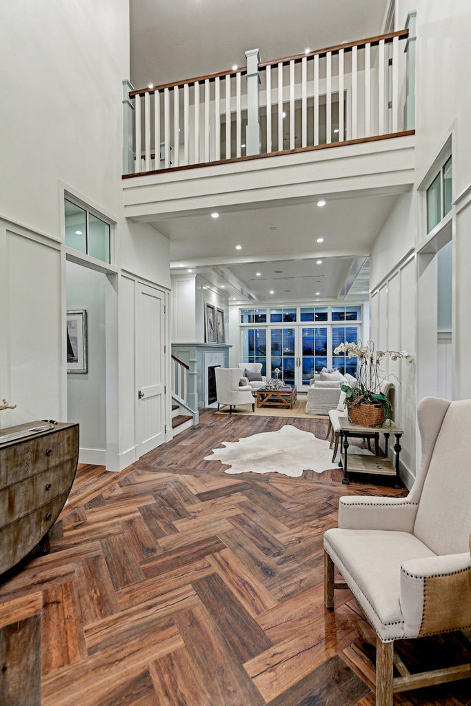 the herringbone patterned floor makes a stunning entry and the cowhide rug is just the right compliment
