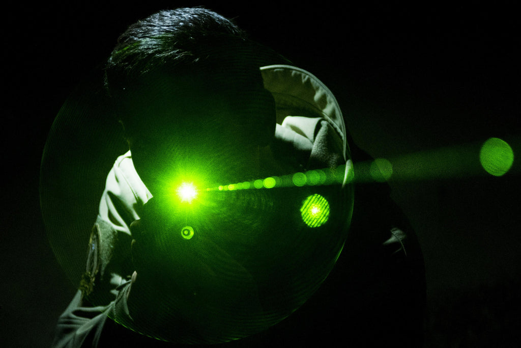 Person using a laser distance measuring tool