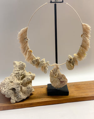 coral necklace with stand