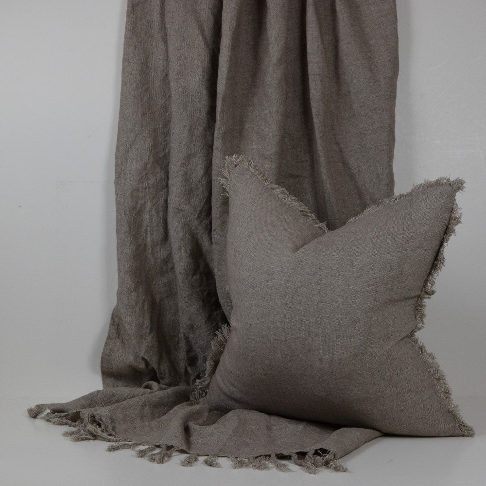 fringed taupe cushion and throw