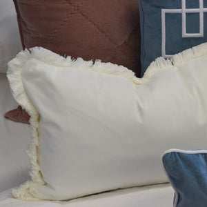 white fringe rectangle cushion cover display