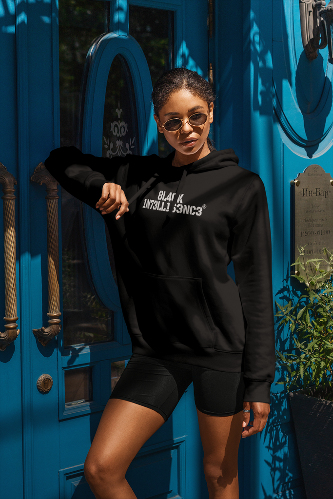 Beautiful Black woman wearing a Black Intelligence black hoodie. The words are in a white military font