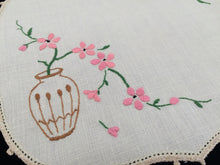 Load image into Gallery viewer, Vintage Embroidered Ivory Linen Doily. Peach Blossom in Vase Design with Ivory Crochet Edging