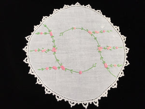 Antique Hand Embroidered White Linen Doily with Pink Flowers and a White Crocheted Lace Edge