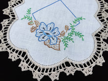 Load image into Gallery viewer, Vintage Hand Embroidered White Linen Doily with Blue Flower and Beige Crocheted Lace Edge