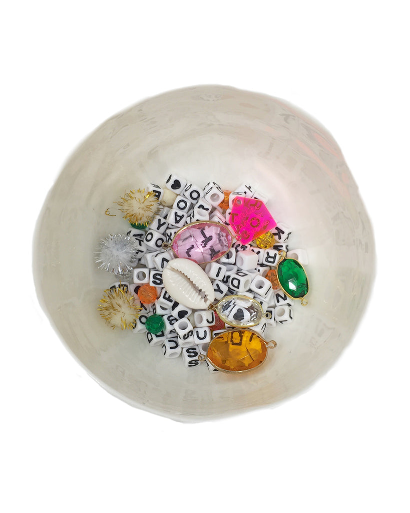 bowl of of charms for jewelry making