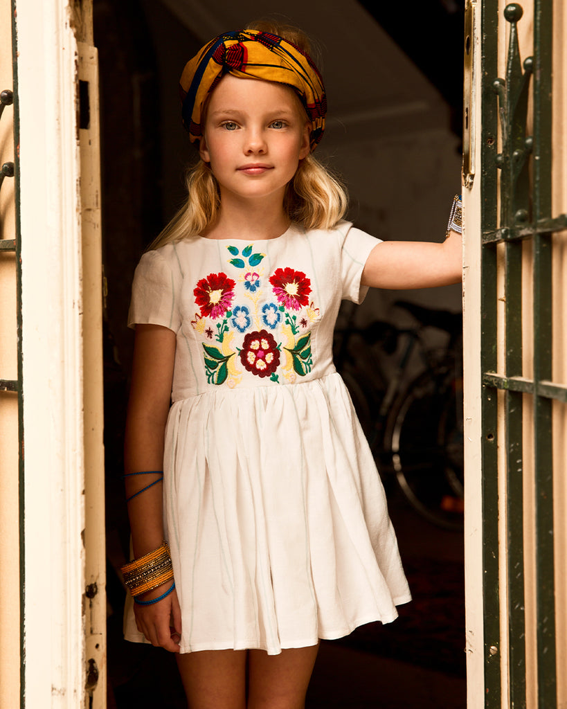 white stripe short sleeve dress with embroidered floral detail on model
