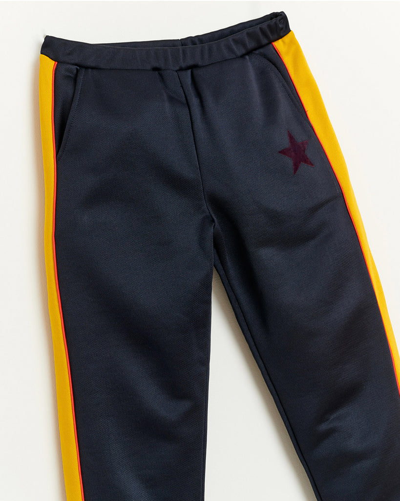 navy sweatpants with yellow side stripes and pockets close up
