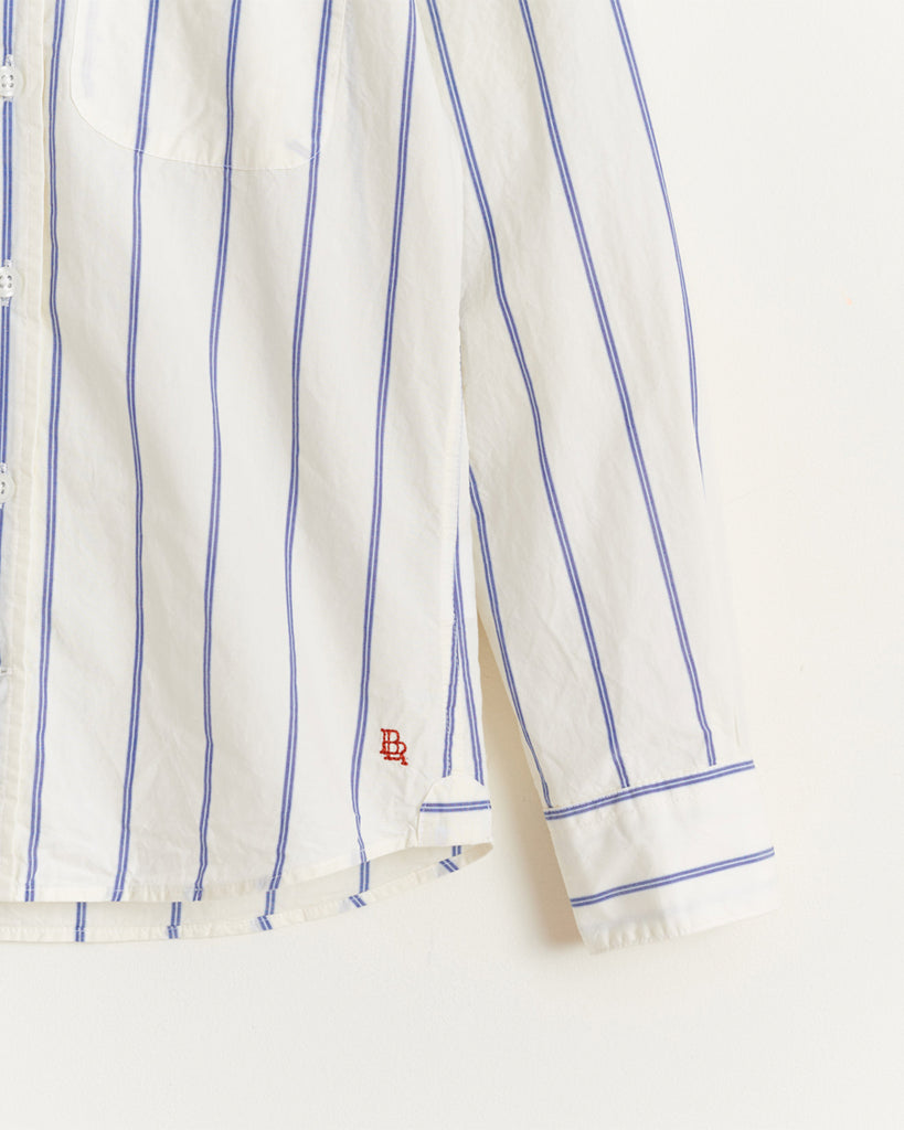 white and blue stripe button up shirt detail