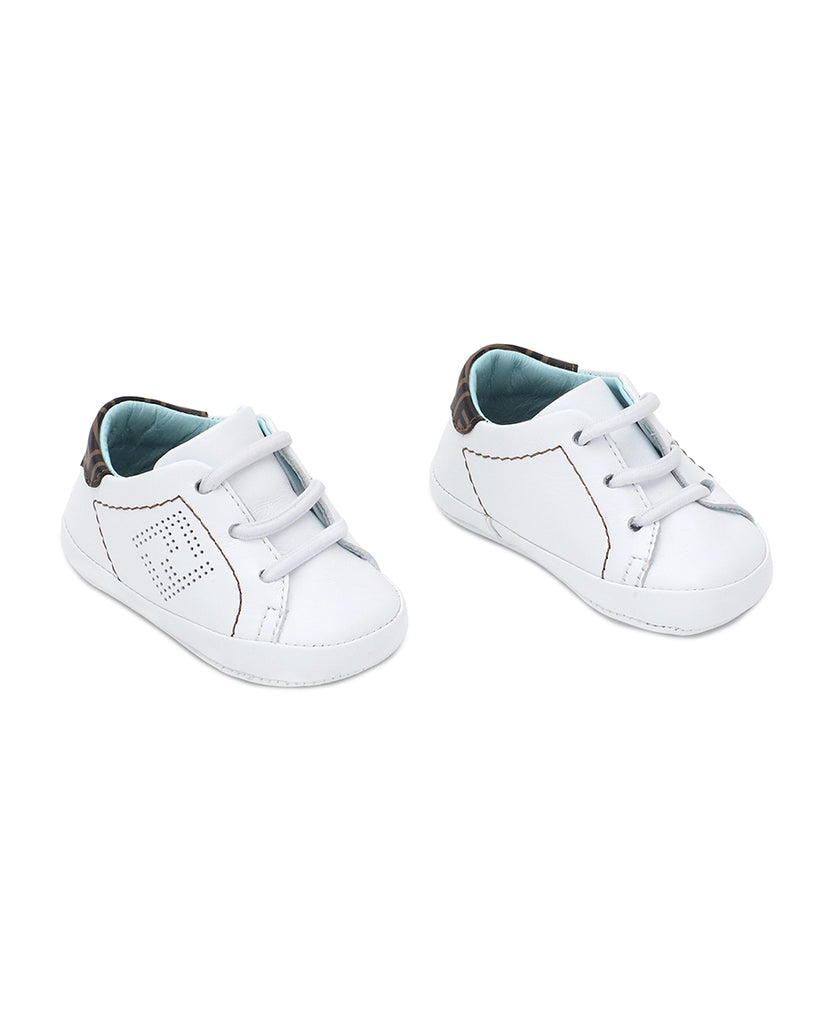 white baby crib shoe sneakers with logo and teal insole