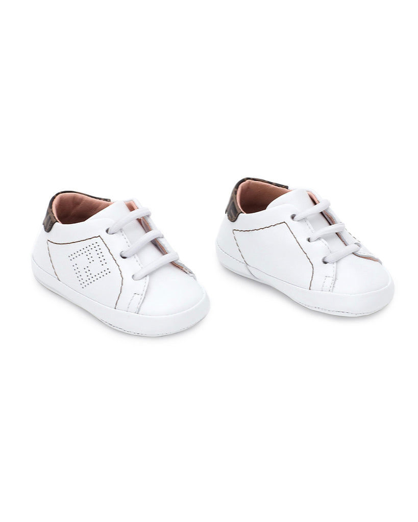 white baby crib shoe sneakers with logo and pink insole