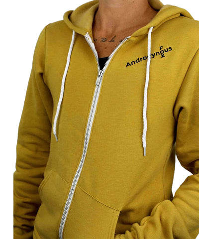 Model wearing mustard colored zip-up hoodie with Androgynous Fox logo printed in black on the left chest.