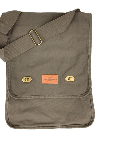 Green Khaki Skulk Satchel with adjustable strap, metal clasps, and quick access inside pocket by Androgynous Fox