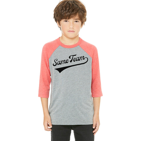 "Boy modeling ""same team"" baseball tee with three quarter length sleeves. Grey/red"