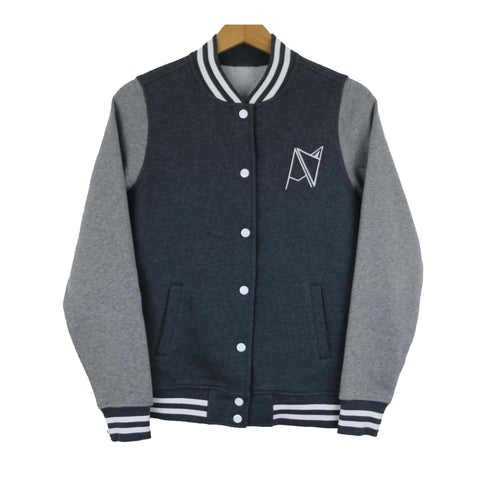 Two-tone varsity style jacket with Androgynous Fox badge logo stitched on left-side breast. Navy body with grey sleeve, snap front, pockets and blue and white stripe elastic detail.