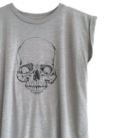 Androgynous Fox stone colored muscle tee with skull printed in black.