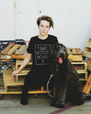 "Girl with dog modeling black crew neck ""take notes boys"" t-shirt by Androgynous Fox."