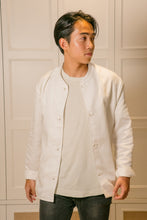 Load image into Gallery viewer, Model wearing mandarin scholar jacket with white t shirt looking to the right