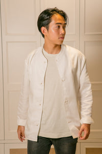 Model wearing mandarin scholar jacket with white t shirt looking to the right